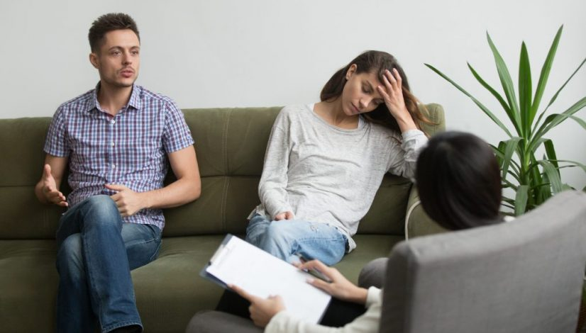 Couple receiving psychological help from expert
